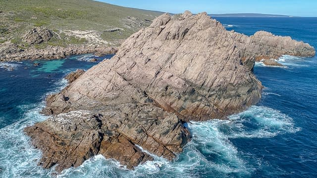 Sugarloaf Rock is on the west coast of Western Australia. It is a large granite rock just a few meters off the coast in the Indian Ocean